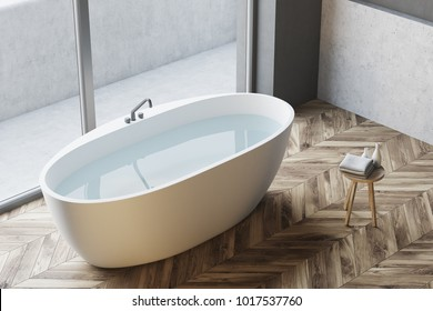 Top view of a white bathtub with water standing on a wooden floor in a panoramic window bathroom. 3d rendering