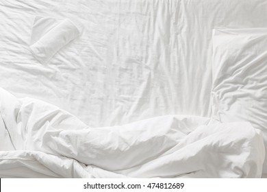 Top view of white bedding and pillow ,towel at morning time