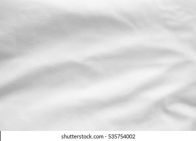 top view of white crumpled fabric texture background