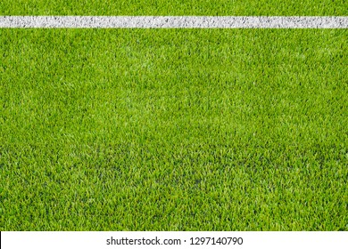 Top view of the white Line marking on the artificial green grass soccer field.