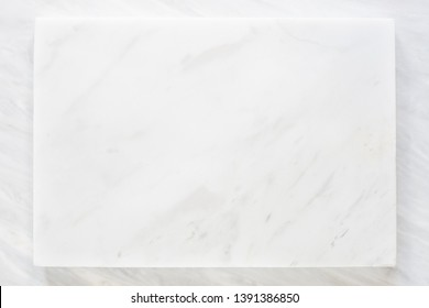 top view of white marble layer with grey marble texture background.