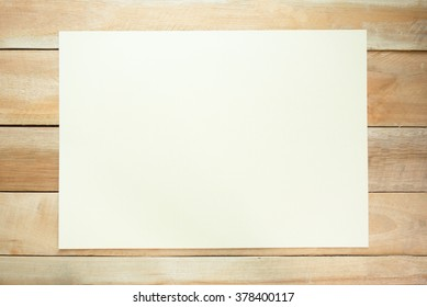 Top view of white paper note on the wood table