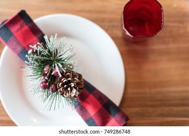 Top view white plate with buffalo check napkin for winter dining (space for copy)