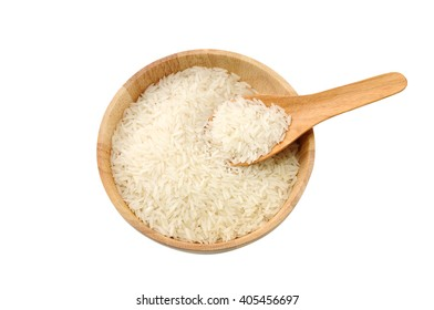 Top view of white rice in wooden bowl with the spoon, isolated on white background.