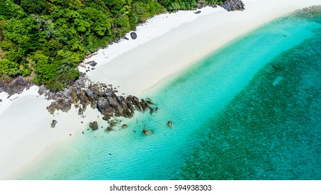 Top view of white sand beach with rock and stone on the beach, Ta Fook island, south of Myanmar, Top view from drone