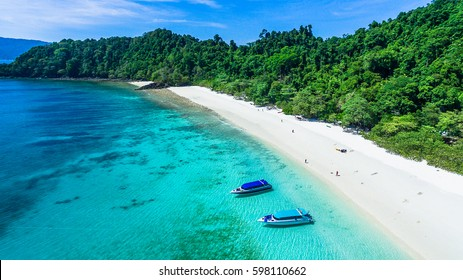 Top view of white sand beach with rock and power speed boat on the beach, Ta Fook island, south of Myanmar, Top view from drone