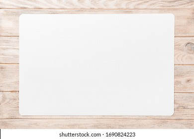Top view of white table napkin on wooden background. Place mat with empty space for your design.