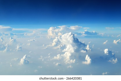 top view from the window of an airplane flying in the clouds.