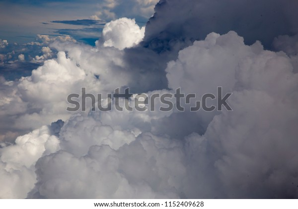 top view from window of airplane flying in clouds