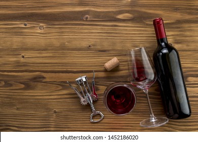 Top view wine bottle with glass on wooden background