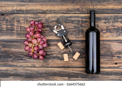 Top view wine bottle with grape on dark wooden background horizontal