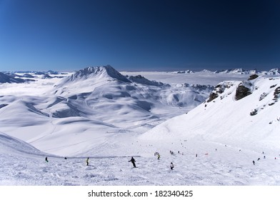 Top view of winter mountain resort Les Arcs with skiers on slopes, France
