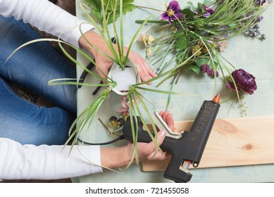 Top view of woman hands with tools during flower decoration