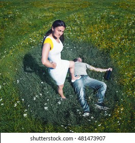 Top view of woman holding her foot on man's body on nature