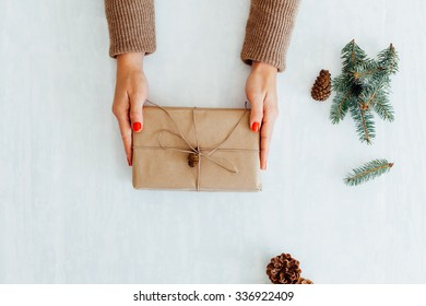 Top view of Woman preparing Christmas gift