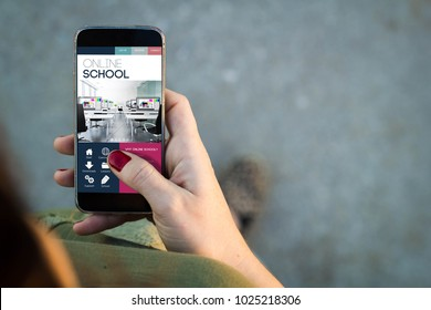 Top view of woman walking in the street using her mobile phone with  online school website All screen graphics are made up.