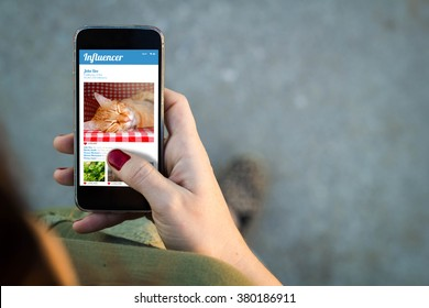 Top view of woman walking in the street using her mobile phone with influencer profile and copy space. All screen graphics are made up.