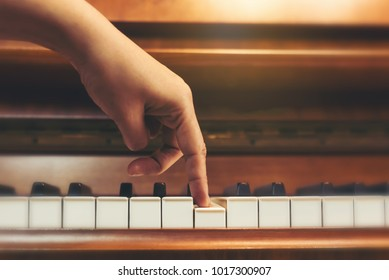 Top view woman's hand playing and practice piano in musicroom at school. Favorite classical music.Show finger walking on piano keyboard.