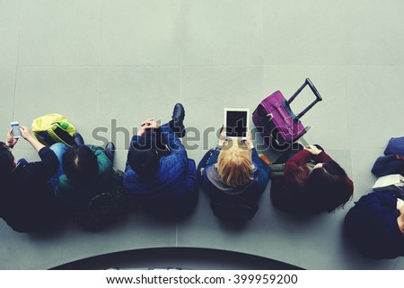 Top view of women tourists are booking on-line hotel for night by using mobile phone and portable touch pad. Young hipster girl is holding digital tablet with empty copy space screen for your content