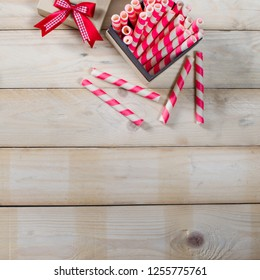 Top view of Wood Table party Christmas holidays, Pink candy, Gift box with ribbon.