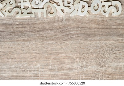 Top view wooden alphabet study english letters,ABC alphabet on wood as a background composition with copy space