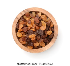 Top view of wooden bowl full of raisins isolated on white