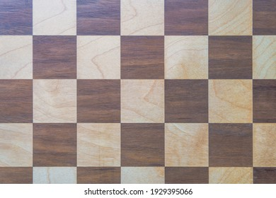 A top view of a wooden chessboard