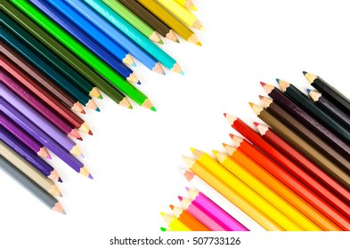 Top view of wooden color pencils isolated on white background.Wallpaper Copy Space in the middle of frame.