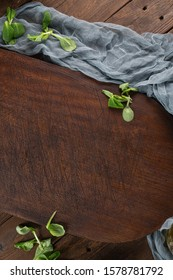 Top view of wooden cutting board on old wooden table countertop with towel and corn salad.