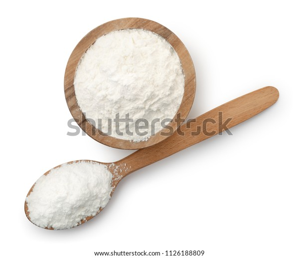 Top view of wooden spoon and bowl full of corn starch isolated on white