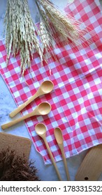 Top View Wooden Spoon or Kitchen Ware on Wooden Background, Kitchen Ware Concept, Cloths Background, Empty Space For Text.