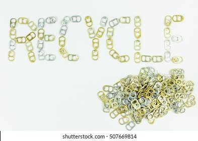 "Top view of wording ""Recycle"" with pile of ring pull by using only gold and silver ring pull aluminum of cans on white background. Concept"