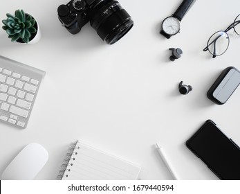 top view of work from home concept with  calculator, notebook, plastic plant, smartphone and keyboard on white background, graphic designer, Creative Designer concept.