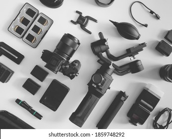 top view of work space photographer with digital camera, Gimbal Stabilizers and camera accessory