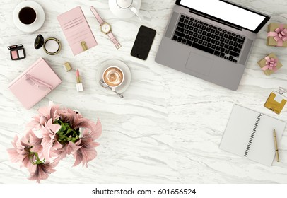 top view working space with laptop,smartphone,flower,cup of coffee and cosmatics  for Beauty and fashion designer,marble background