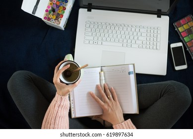 top view of working woman at home