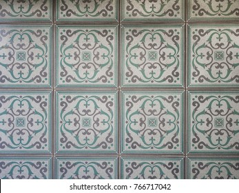 Top view of worn out real floor tile -  Cyclic symmetry art pattern.
