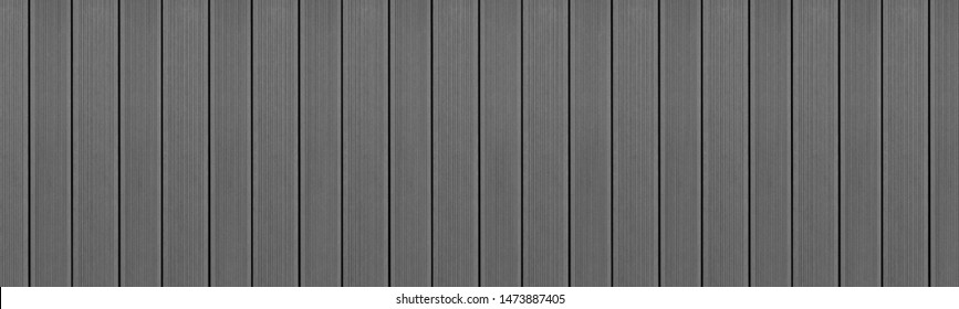 Top view of WPC in gray color. WPC: Wood-Plastic Composites are wood fiber and thermoplastic such as PE, PP, PVC, or PLA. A WPC decking are stylish and enrich the outdoor living