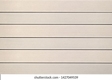 Top view of WPC in light brown color. WPC: Wood-Plastic Composites are wood fiber and thermoplastic such as PE, PP, PVC, or PLA. A WPC decking are stylish and enrich the outdoor living