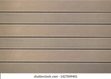 Top view of WPC in oak color. WPC: Wood-Plastic Composites are wood fiber and thermoplastic such as PE, PP, PVC, or PLA. A WPC decking are stylish and enrich the outdoor living