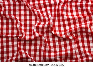 Top view wrinkled tablecloth red tartan in cage texture wallpaper horizontal. Unique perspectives.