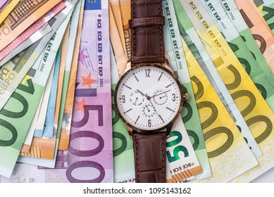 Top view of wrist watch on euro banknotes