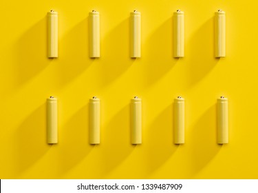 Top view yellow AAA alkaline batteries colorful pop art style flat lay photo pattern