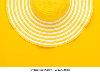 top view of yellow striped retro hat close-up with copy space