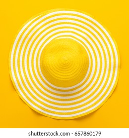 top view of yellow striped retro hat close-up. summer concept