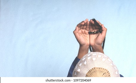 Top view of young muslim boy praying dua during the holy month of Ramadan. Isolated background