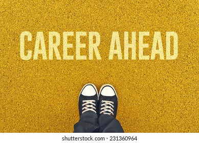 Top View of Young Unemployed Man standing on street pavement in front of Career Ahead sign printed.