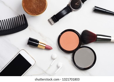 Top view of young women outfit with make up. Women's essentials for everyday.