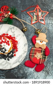 top view yummy creamy cake with raisins and christmas toys on light-dark background sugar cookie new year sweet