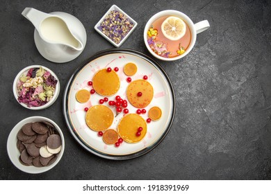 top view yummy pancakes with tea on grey background fruits dessert sweet